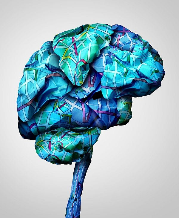 Brain mapping mental health concept and psychology challenge symbol or brainstorming icon as a group of crumpled paper road maps shaped as a human mind in a 3D illustration style.
